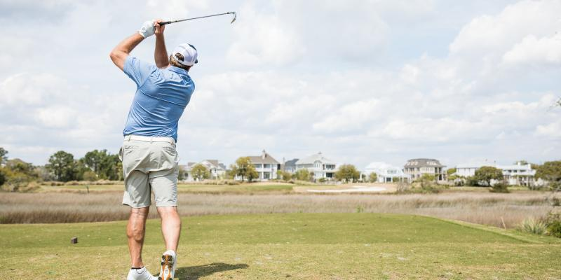 This is a photo of a man golfing in shorts and blue shirt for NEEDTOBREATHE Classic.