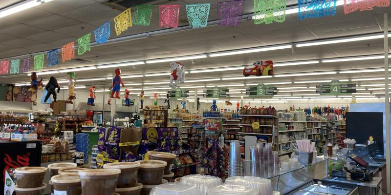 This is a picture of the ceiling at El Molino supermarket in West Ashley with flags and pinatas.